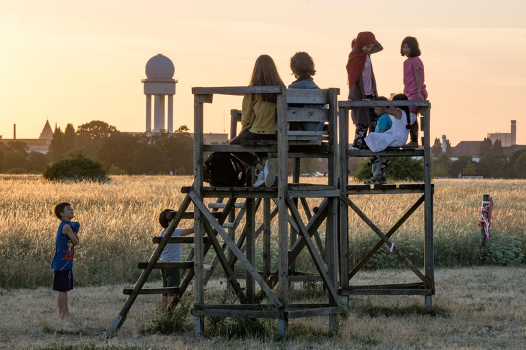 Kids watching sunset at former Tempelhof airport, Berlin