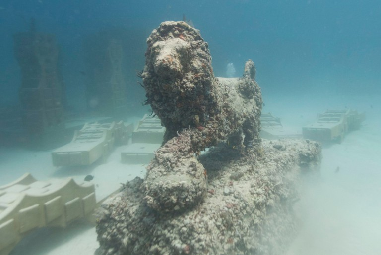 A lion sculpture is sits among parts for a new section of the Neptune Memorial Reef near Miami Beach, Fla. The Neptune Memorial Reef, an underwater cemetery modeled after the lost city of Atlantis, is undergoing a massive expansion off the coast of Miami Beach Coral Reef Cemetery, Miami Beach, USA