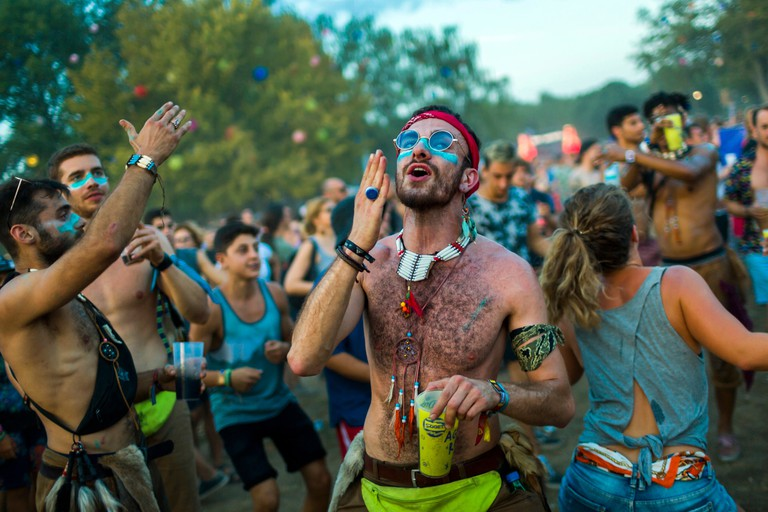 Mandatory Credit: Photo by Balazs Mohai/EPA-EFE/REX/Shutterstock (9787290at) Festival-goers on the third day of the 26th Sziget (Island) Festival on Shipyard Island, Northern Budapest, Hungary, 10 August 2018. The Sziget Festival is one of the biggest cultural events of Europe offering art exhibitions, theatrical and circus performances and above all music concerts. 26th Sziget (Island) Festival, Budapest, Hungary - 10 Aug 2018