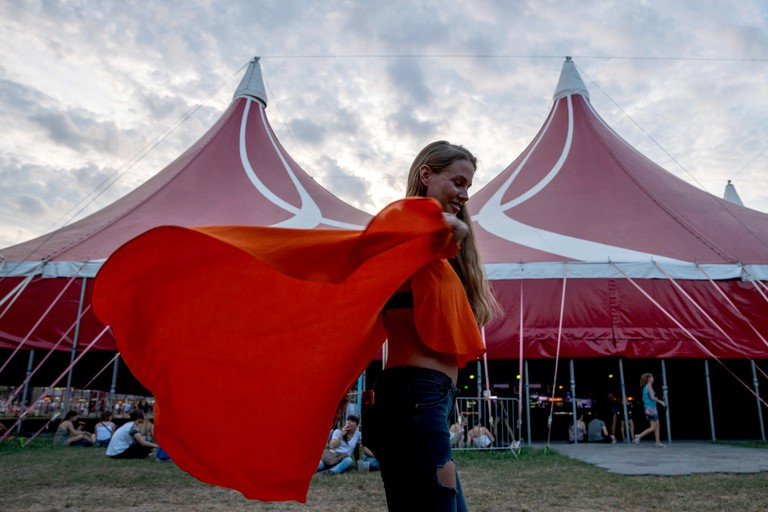 A festival-goer dances on the third day of the 26th Sziget (Island) Festival on Shipyard Island in northern Budapest