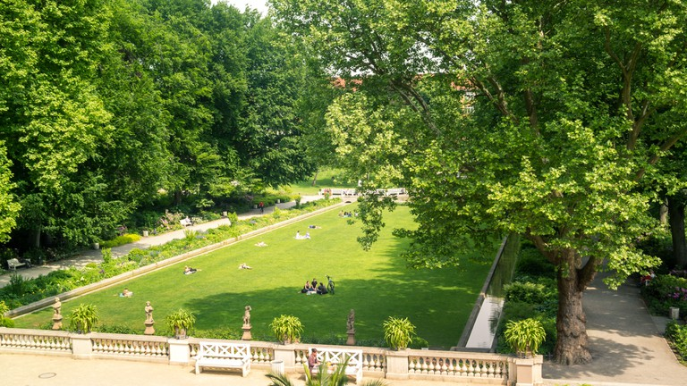 Körnerpark in Berlin shot from high angular on a bright day. The neo baroque style park resembles a palace garden