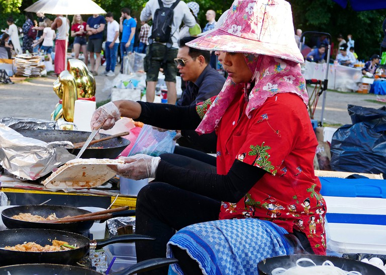 Women cooking in Thai Park (editorial use only)