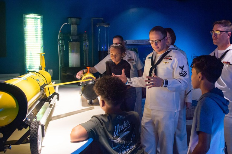 The Naval Oceanography Office educates children about Navy oceanography gliders during Miami Navy Week at the Phillip and Patricia Frost Museum of Science. Miami, Florida.