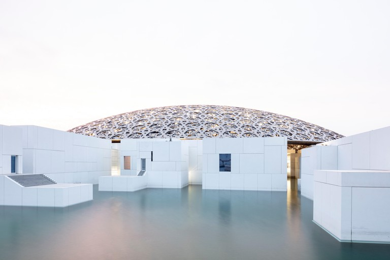 SAADIYAT ISLAND, ABU DHABI, UNITED ARAB EMIRATES - April 12, 2019: The Louvre Abu Dhabi on Saadiyat Island, designed by architect Jean Nouvel. ( Ryan