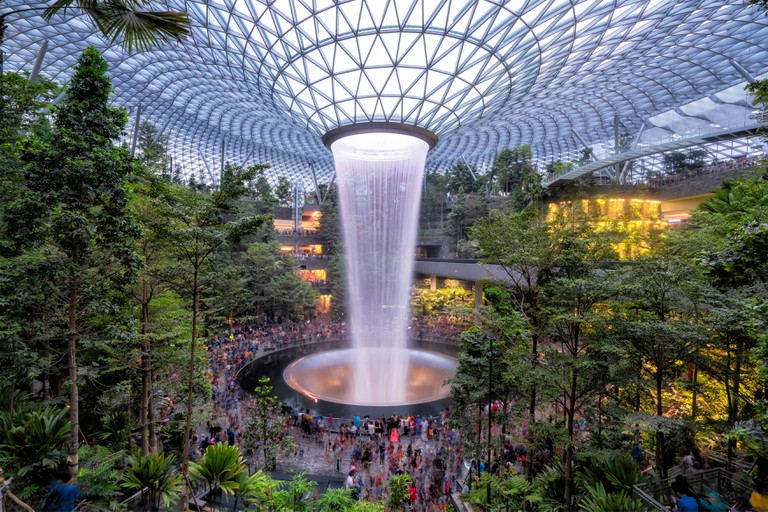 Singapore - April 19: Singapore citizen go to see the amazing indoor waterfall at Jewel in Changi Airport.