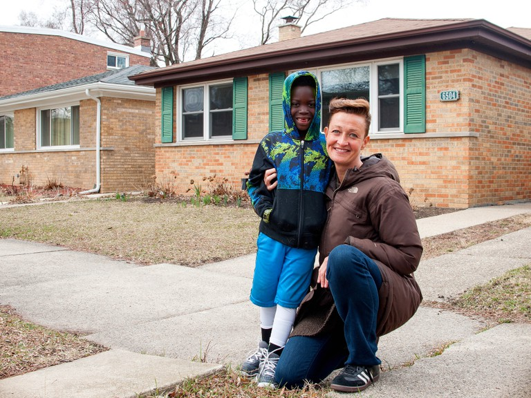 A Folded Map participant with one of her Map Twins in front of his home on the South Side.