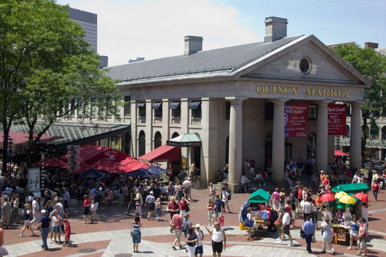 Tourists and shoppers at Quincy Market (also known as Faneuil Hall Market Place) in Boston Massachusetts, USA