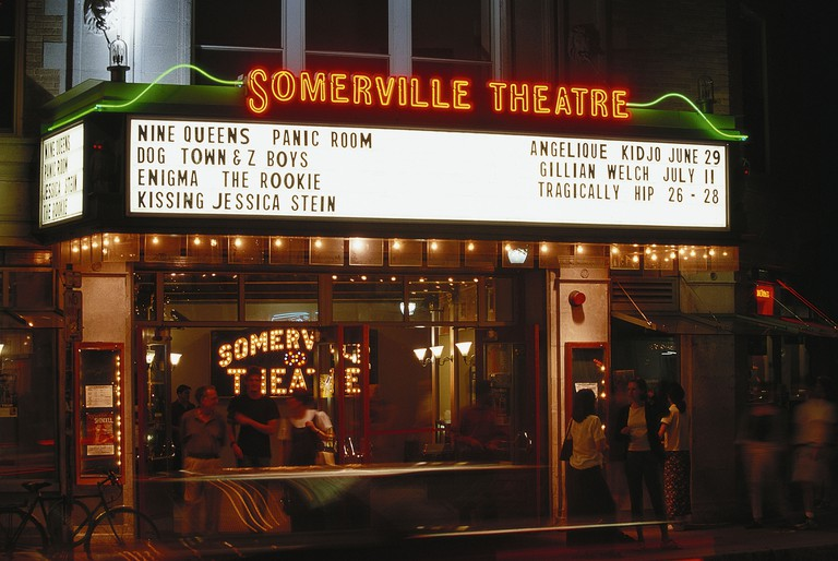 USA, Massachusetts, Boston, Somerville Theater, people gathered outside and neon sign, entrance , blurred motion