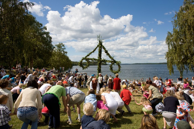 Dancing round the Maypole at Midsummer (Sweden). Image shot 2008. Exact date unknown.
