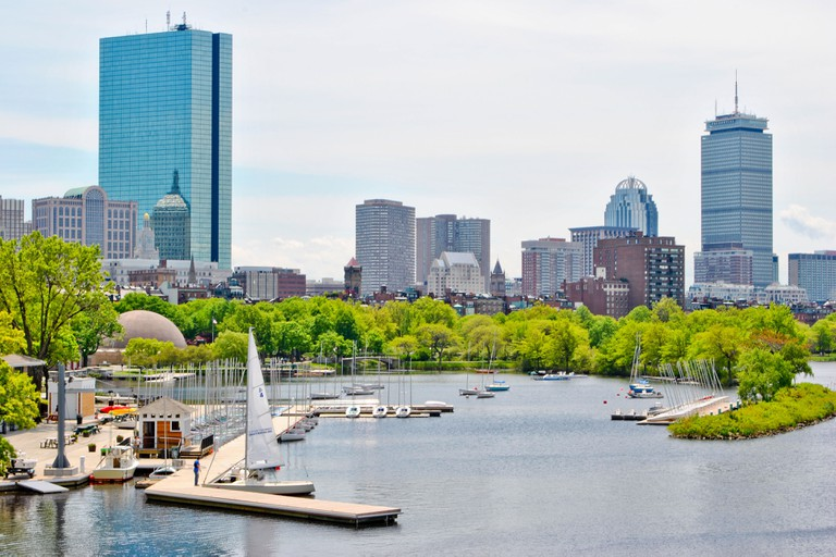 View of the Boston skyline with modern buildings and Charles river.