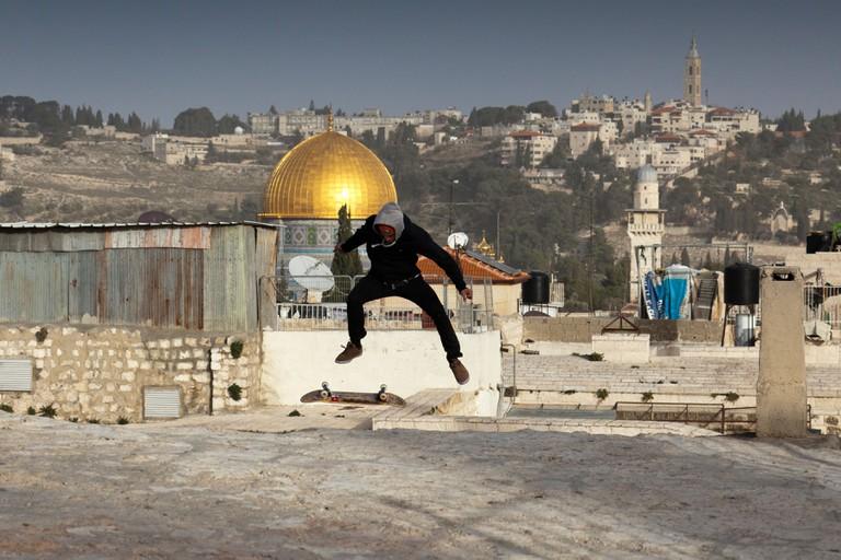 An Israeli teenager skateboarding in the Old City in Jerusalem.