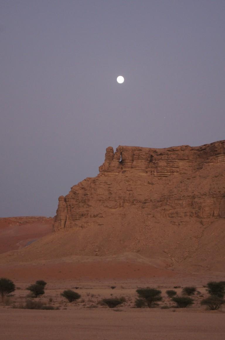 The moon over the Red Sands desert, Riyadh, Kingdom of Saudi Arabia.