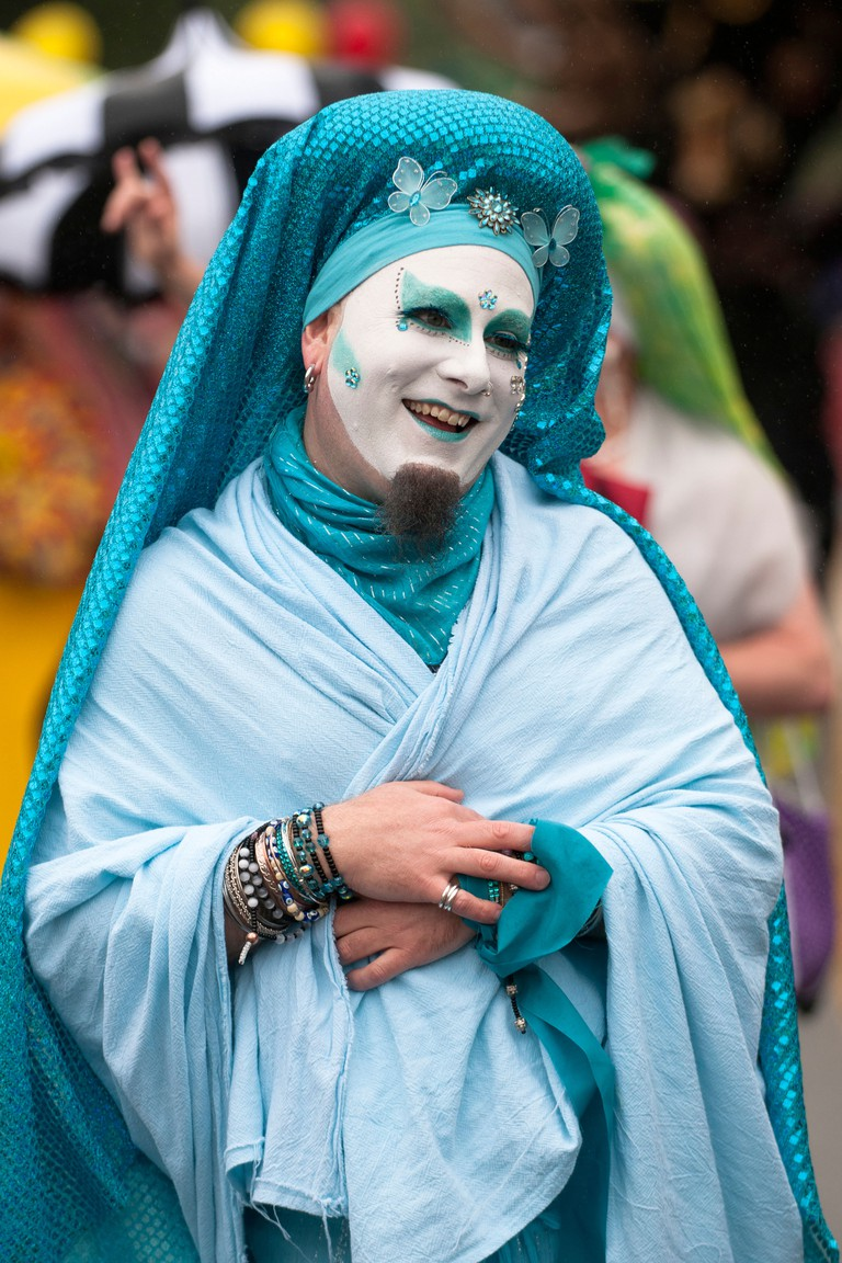 A sister walks in the Fremont Solstice Parade in Seattle