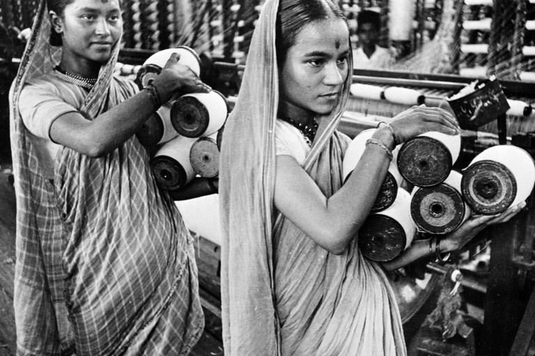 Photograph taken during war-time India of a young female workers in a booming Bombay textile mill. Dated 1943. Image shot 1943. Exact date unknown.