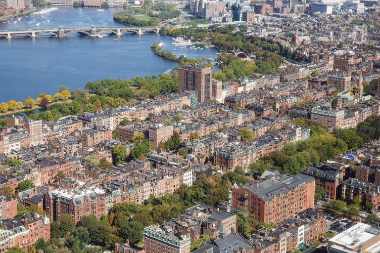 Aerial view of  Back Bay and Beacon Hill in Boston, Massachusetts on a clear sunny day with the Charles River in the background.
