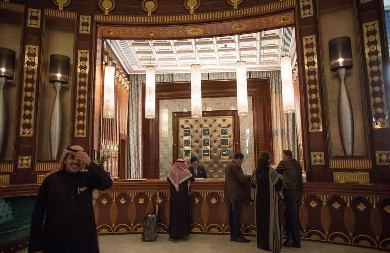 Hotel guests stand in the luxurious reception area of the Ritz-Carlton hotel in Riyadh, Saudi Arabia.