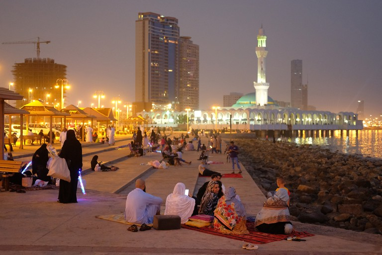 People relax on a Friday evening along the Corniche waterfront in Jeddah