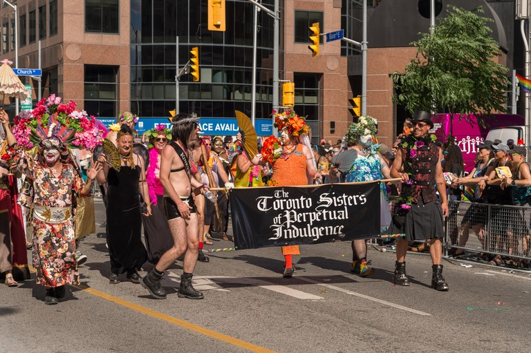 The local branch of the Sisters of Perpetual Indulgence marches at the Toronto Pride Parade