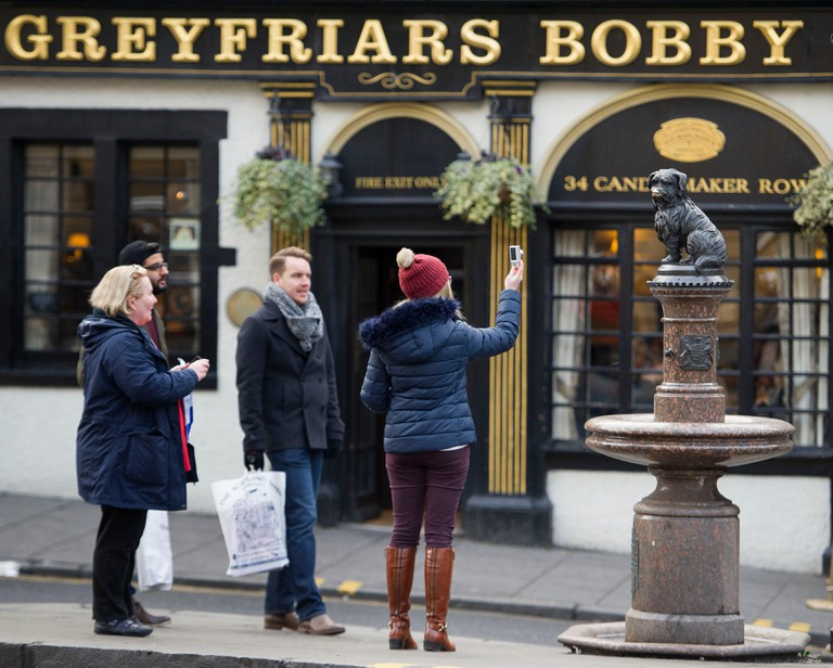 The Greyfriars Bobby statue sits on the corner of Candlemaker Row