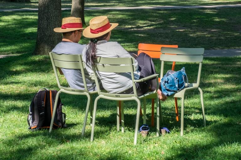 Two people sitting in Harvard Yard - Harvard Square, Cambridge, Massachusetts