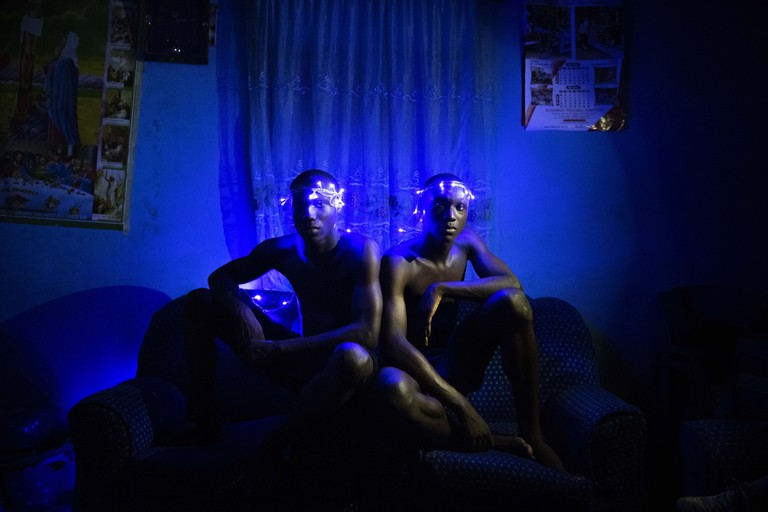 Ikpeme and Lwanga wearing a crown of blue Christmas lights