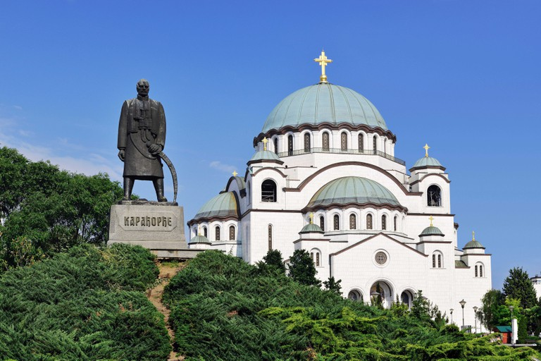 Belgrade, Serbia, Monument to Karadjordje with the Church of Saint Sava in the background.