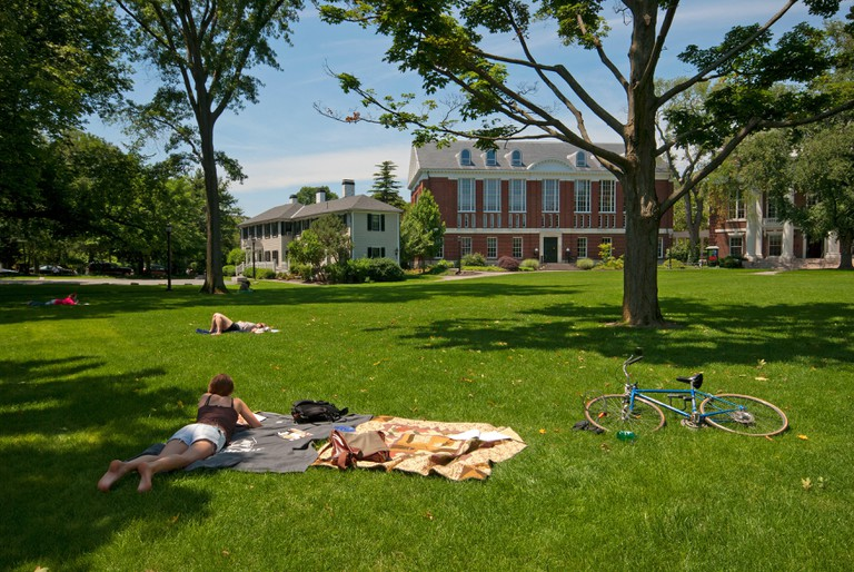 Students relaxing in Radcliffe Yard, Harvard University, Cambridge, Boston, Middlesex County, Massachusetts, USA