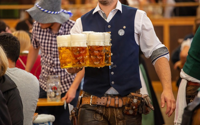 Waiter serving German beers