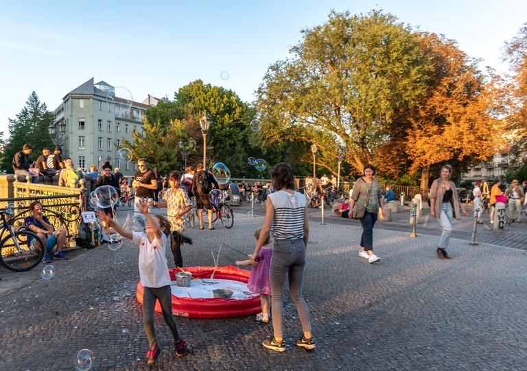 children playing with Admirals bridge  in summer , sunset, Landwehrkanal , Kreuzberg, Berlin, Germany