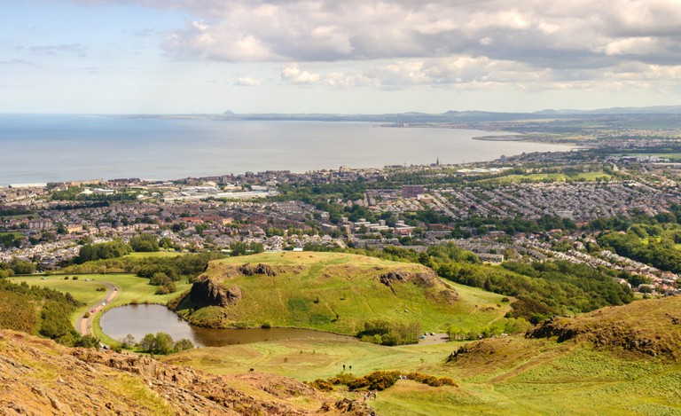 Houses of Portobello, Musselburgh, Presponpans and Cockenzie line the Firth of Forth Coast as viewed from above Dunsapie Loch on Arthur's Seat hill in