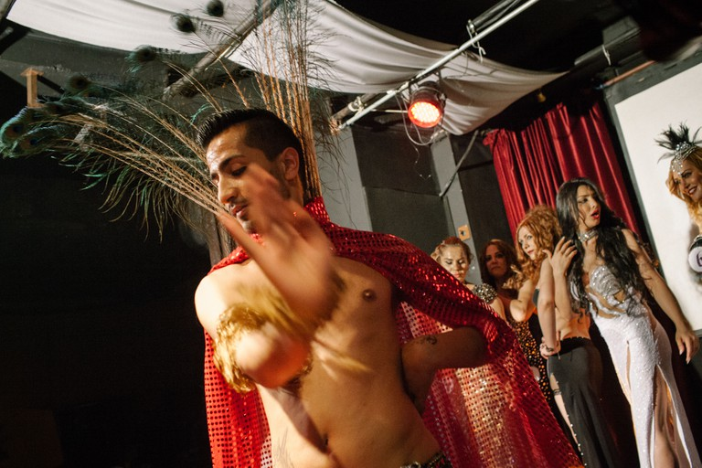 A male Zenne dancer performs infront of women lined up on stage as fellow contestants and hosts introduce them infront of the eager crowd at the Trans Beauty Pageant, organised by Angel of Turkey to raise awareness, break stereotypes and help financially towards a shelter for Trans women in the city.