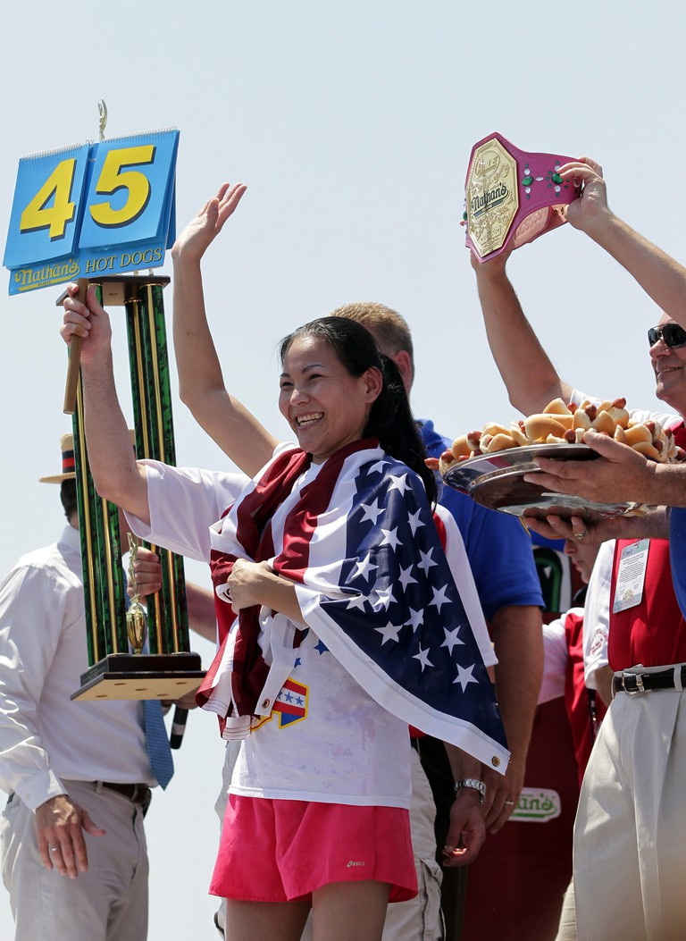 "Sonya ""The Black Widow"" Thomas waves to fans after the Nathan's Famous Fourth of July International Hot Dog Eating Contest in Coney Island, NY on July 4, 2012. Thomas wins the competition by eating 45 hotdogs and breaking her world record.     UPI/John An"
