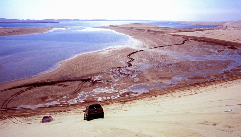 4x4 driving and fishing on the Inland sea Khor al Udeid, south of Doha in Qatar in the Arabian Gulf Middle East