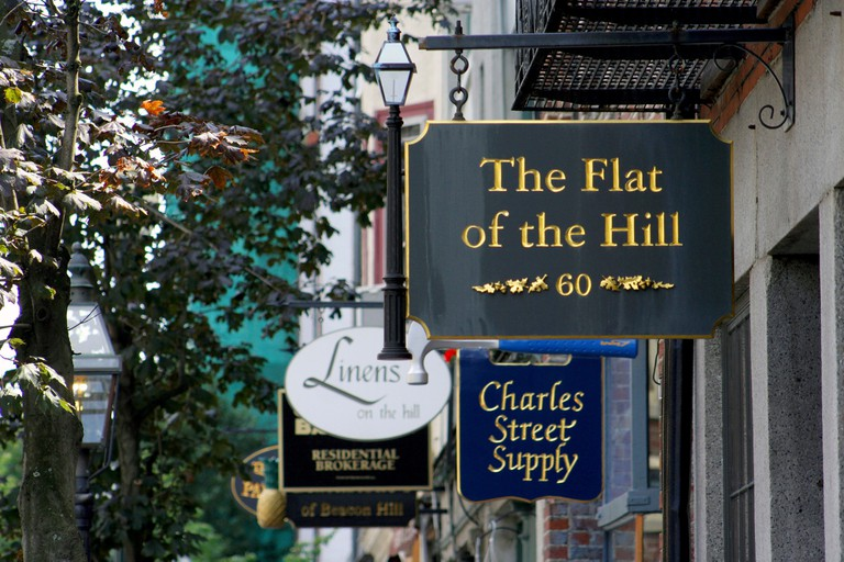Shop signs on Charles Street in Beacon Hill Boston known for its antique and boutique shops