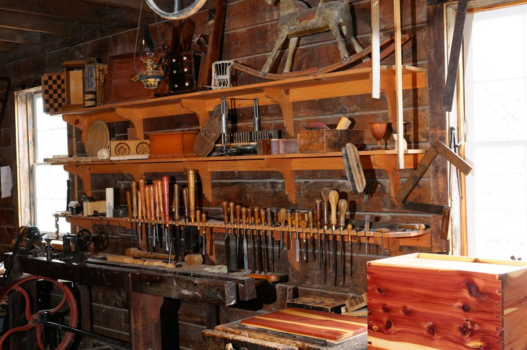 Historic 1867 cabinet makers shop with lathe in Black Creek Pioneer Village Toronto