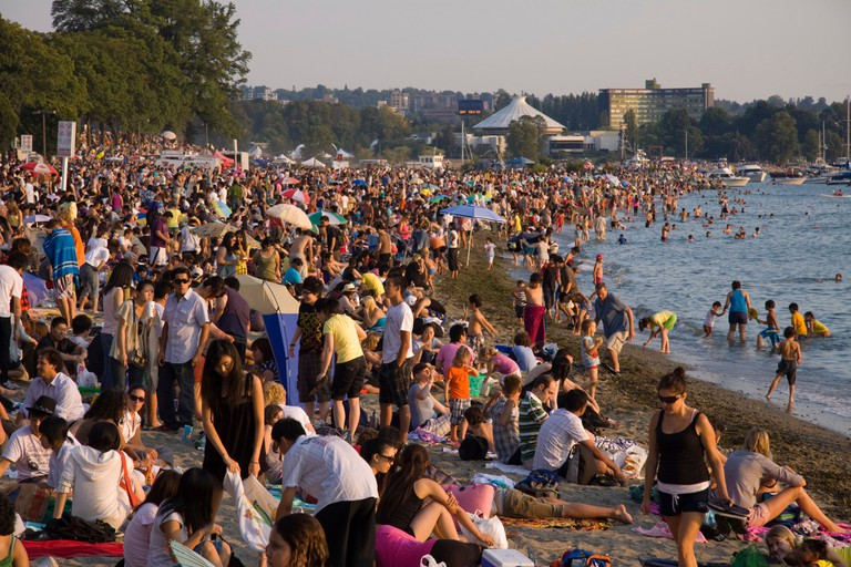 Crowd gathers at Sunset on English Bay, Vancouver. Waiting for Celebration of Light Festival
