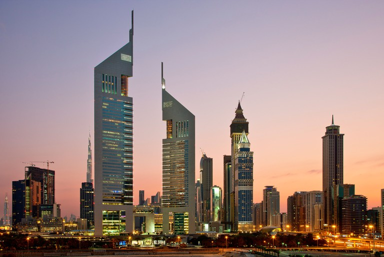 Emirates Towers and skyscrapers at dusk, Dubai