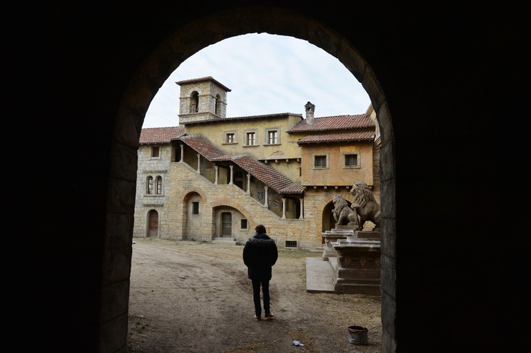 An archway and houses are pictured in a film set at the Korda Studios in Etyek near Budapest, Hungary.