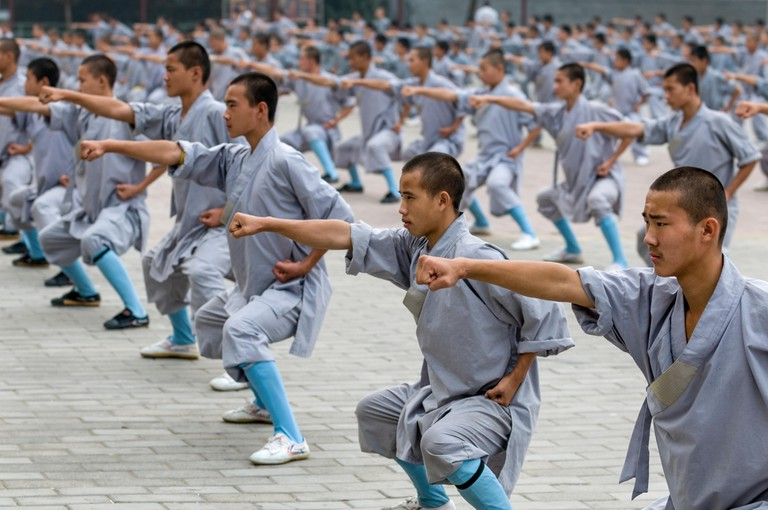 Youths train in Kung Fu at the Songshan Shaolin Temple, Dengeng, Henan Province