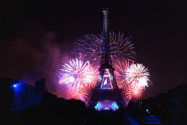 night scene of fireworks at Eiffel Tower in Bastille Day, National Day of France, July 14, 2013 in Paris France