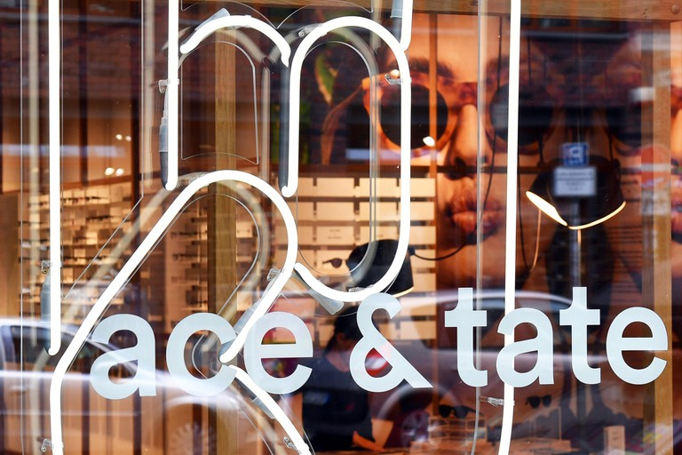 Berlin, Germany. 23rd Aug, 2016. The logo of the Dutch glasses brand 'Ace and Tate' at the flagship store of the brand in Neue Schonhauser Strasse in Berlin, Germany, 23 August 2016. Photo: Jens Kalaene/dpa/Alamy Live News