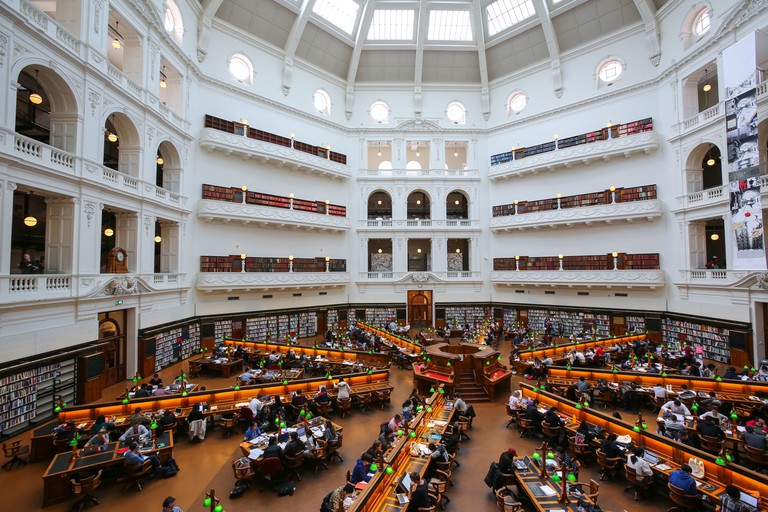State Library of Victoria in Melbourne, Australia. Top view of interior of La Trobe Reading Room with reading students.