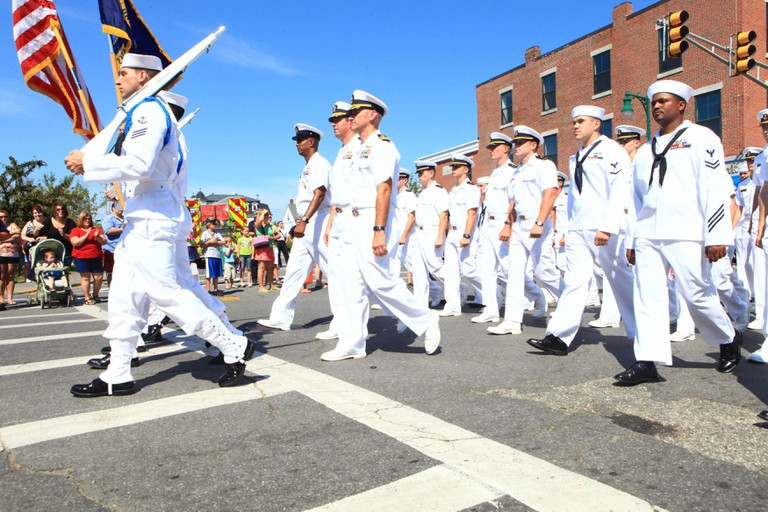 The crew of the USS San Antonio marches through the streets of Rockland, Maine, during the 2012 Lobster Festival, Aug. 4.