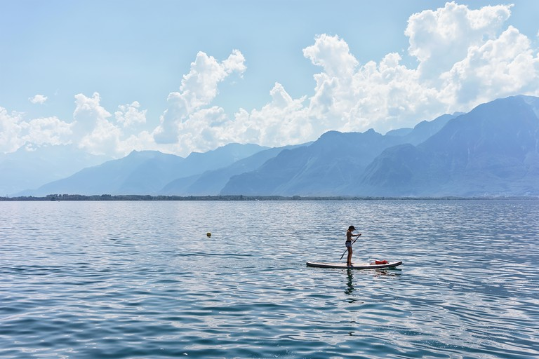 Enjoy a peaceful paddleboard ride on Lake Geneva