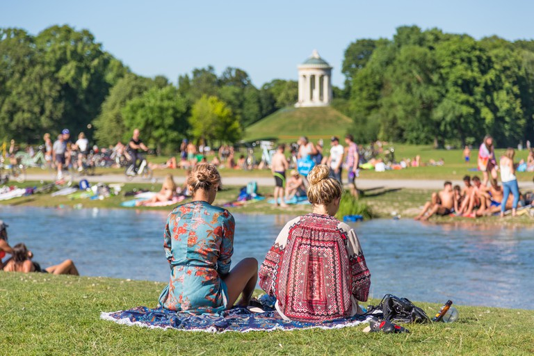 People enjoying the water in Englischer Garten
