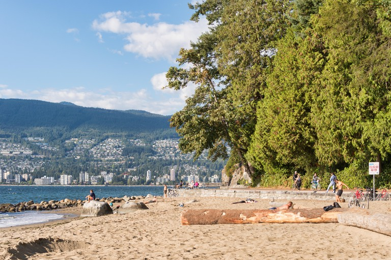 People enjoying summertime at Third Beach in Stanley Park, Vancouver.