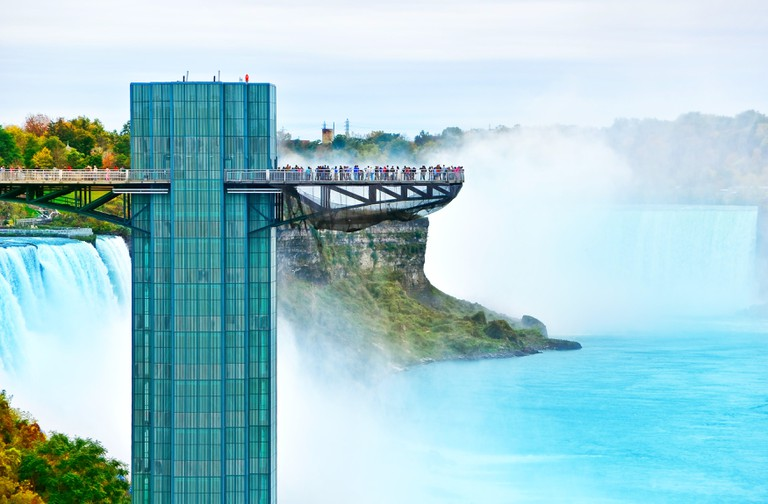 View of Niagara Falls and observation tower in autumn.