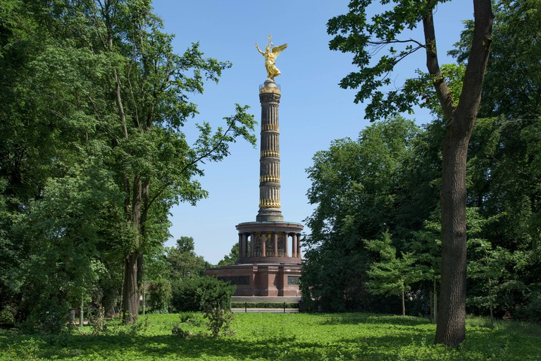 a view of the popular Victory Column in Berlin, Germany, seen from the Tiergarten park