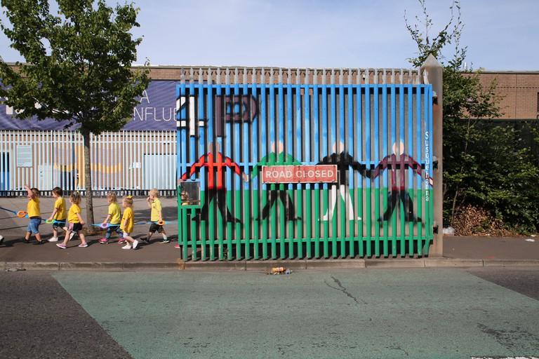 Kids crossing the Peace Wall in Belfast