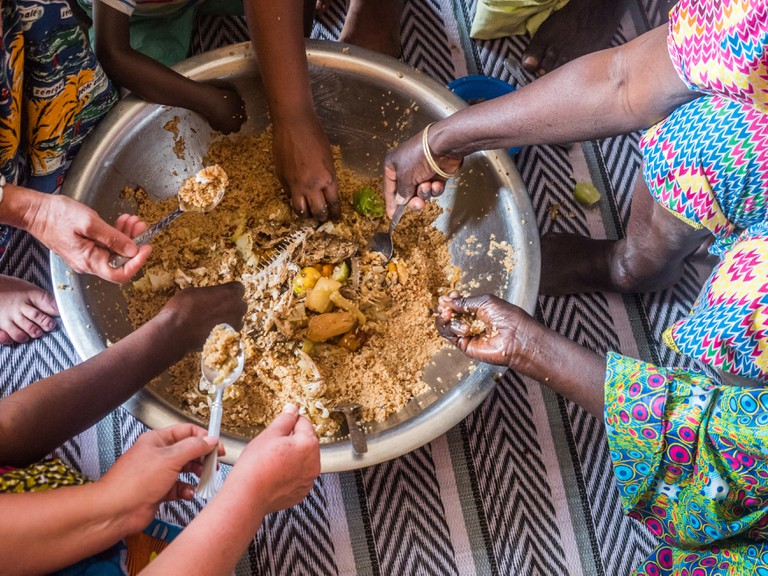 Senegalese family eating together